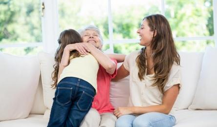 senior-woman-hugging-granddaughter
